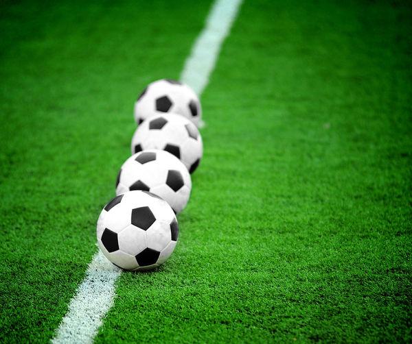 Soccer Balls On Field