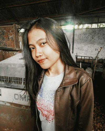 Portrait of woman wearing leather jacket