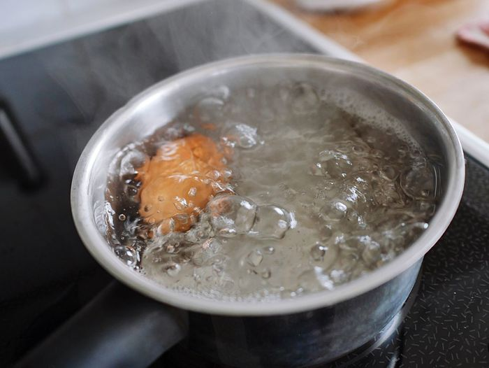 Close-up of boiling egg