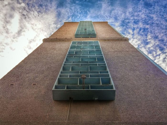 To heaven...? The City Light Low Angle View Architecture Sky Building Exterior Built Structure No People Cloud - Sky Outdoors Day Sunlight Light Light And Shadow City Clouds Tower Pathway To Heaven Immensity Minimalist Architecture Minimalist Architecture The Architect - 2017 EyeEm Awards Break The Mold