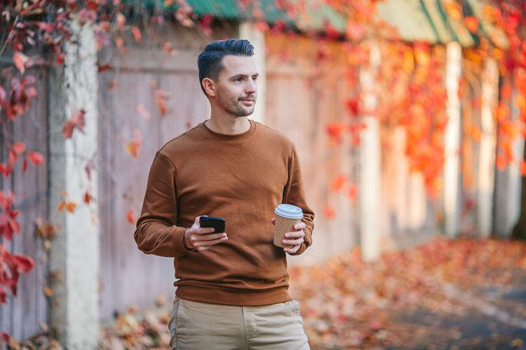 Full length of man using smart phone outdoors