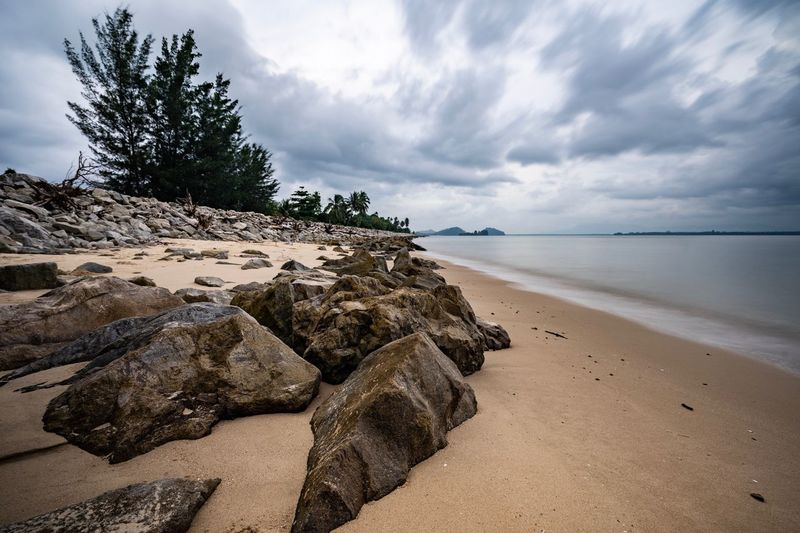 Long exposure shot of Pantai Puteri, Santubong, Kuching, Malaysia with big rocks as foregrounds Pantai Puteri Malaysia Sarawak Beach Borneo Santubong Long Exposure Sky Beach Land Cloud - Sky Beauty In Nature Sea Water Sand Tranquil Scene Plant Scenics - Nature Idyllic No People Nature Tranquility Tree Horizon Over Water Non-urban Scene Outdoors Day