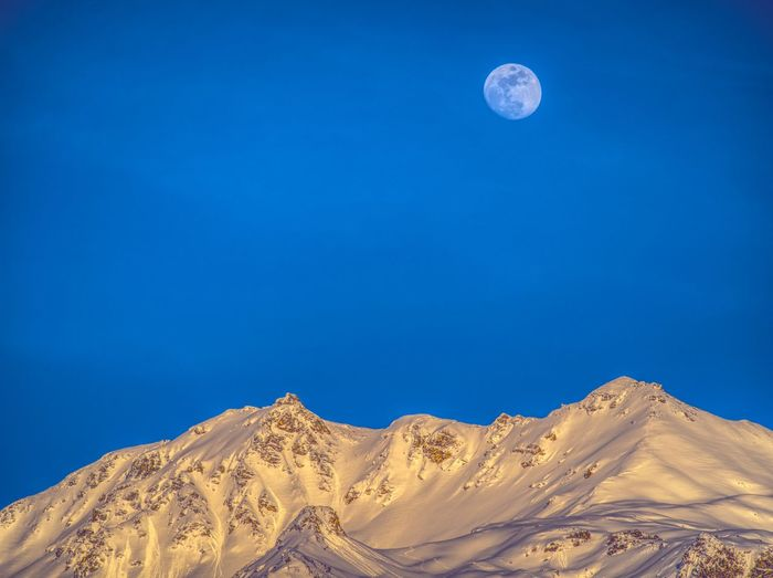 Beauty In Nature Blue Clear Sky Full Moon Landscape Low Angle View Moon Moon Rise Mountain Range Mountains And Sky Nature Outdoors Scenics Sky