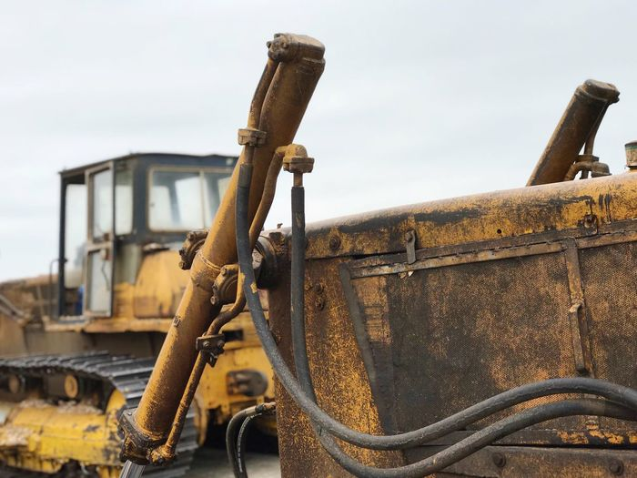 Rusty earth mover against clear sky