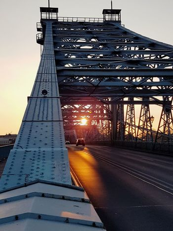 Sunset_collection Sunset Silhouettes Car Street Orange Color Orange Sky Driving Steel Structure  Steel Bridge Bridge - Man Made Structure No People Sunset Travel Destinations Outdoors Sunlight Architecture Day Landscape Sky Stories From The City