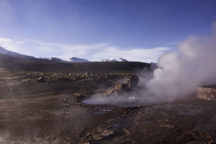 A panorama of the El Tatio geyser field with steam rising in the morning. Andes Mountains Atacama Desert Chile Hot Springs Panorama Steam Travel Photography Vista Beauty In Nature Geology Geyser Hot Spring Landscape Mountains No People Scenics Snowy Mountains South America Travel Destinations