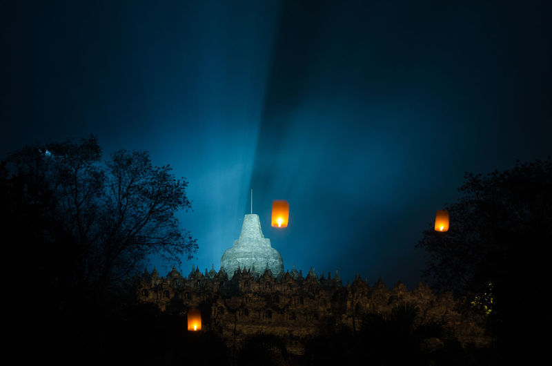 amazing lampion waisak / vesak at borobudur temple, indonesia Architecture Belief Building Building Exterior Built Structure Dusk Full Moon Illuminated Lighting Equipment Low Angle View Moon Moonlight Nature Night No People Outdoors Place Of Worship Plant Religion Sky Spirituality Tree