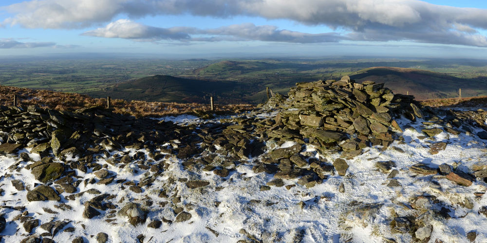 Barely above the snow line Keadeen Rock Pile Cairn Cloud - Sky Landscape Mountain Top View Outdoors Snow Sunny Day