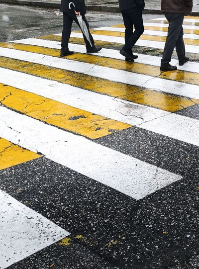 Gettyimages Low Section Zebra Crossing Human Leg Walking Human Foot Human Body Part Pedestrian Crossing City Safety Men Adult Lifestyles People Business Two People Road Businessman Transportation Adults Only Minimal Getty X EyeEm Gettyimagesgallery