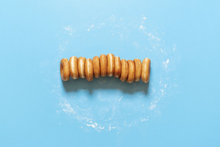 High angle view of bread on blue background