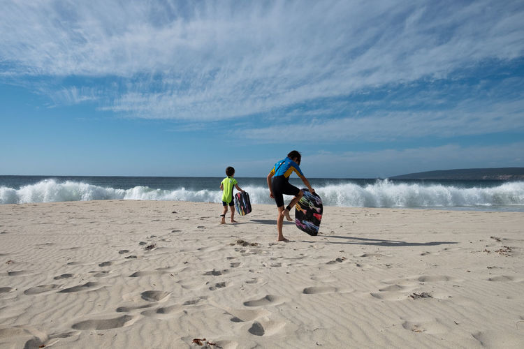 Let's go! Australia Kids Being Kids Beach Beach Day Beauty In Nature Horizon Horizon Over Water Kids Playtime Land Leisure Activity Lifestyles Nature Outdoors Real People Rear View Sand Scenics - Nature Sea Sky Son Surfing Togetherness Walking Water