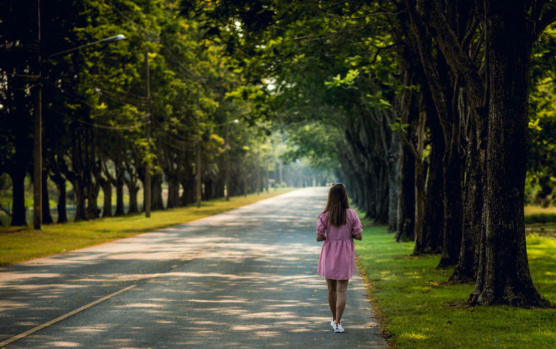 Adult Casual Clothing Day Direction Fashion Footpath Full Length Growth Nature One Person Outdoors Plant Rear View Solitude Standing The Way Forward Tree Treelined Walking Women