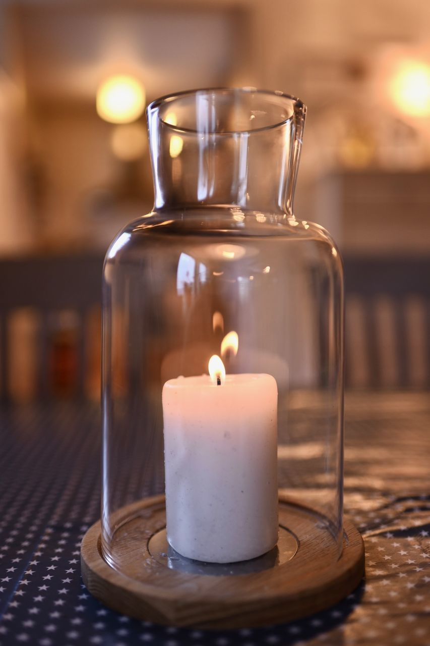 candle, indoors, fire, flame, table, burning, transparent, focus on foreground, close-up, glass - material, fire - natural phenomenon, container, no people, illuminated, wood - material, jar, still life, heat - temperature, food and drink, glass, tea light, temptation