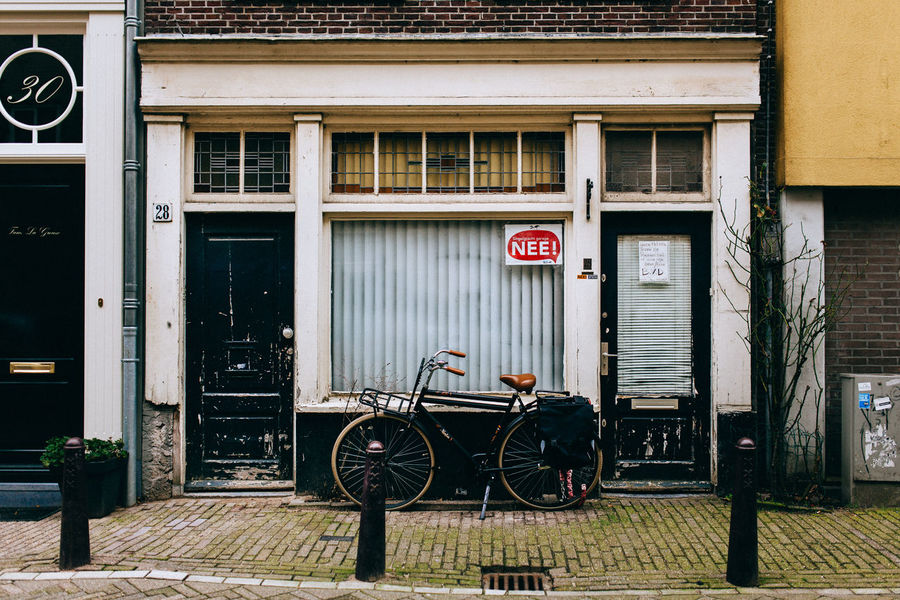 A Wintery Amsterdam... All Streets Amsterdam Architecture Bicycle Building Exterior Built Structure Capital Letter City Closed Communication Door Information Information Sign Land Vehicle Mode Of Transport Non-western Script Sign Text Transportation Warning Sign Western Script Window Your Amsterdam