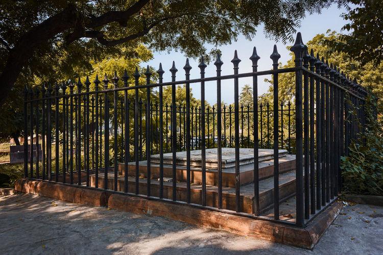 View of metal gate against sky