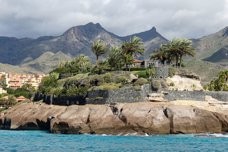 View on costa adeje on canary island tenerife with mountain range in the background
