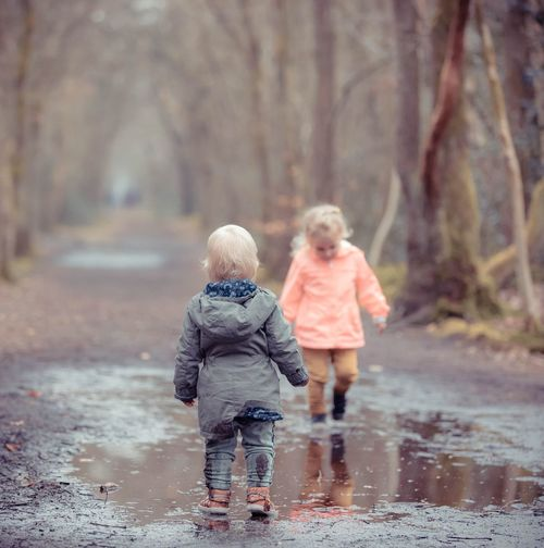 Child Childhood Full Length Two People Family Winter Togetherness Wet Clothing Nature Walking Real People Rain Offspring Females