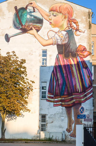 Girl watering chestnut Białystok Chestnut Day Girl Outdoors Street Art Tree Watering Can