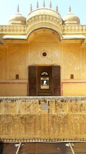 Watching a man watching the world Incredible India Jaipur Rajasthan Windows Watchingpeople Watchingpeoplewatching Yellow Windows View Architecture Palace