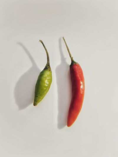 Chillies Red Chillies Green Chilli Shadow Big And Small Hot Spicy Mobile Photography Chilli White Background Studio Shot Fruit Red Drink Close-up Food And Drink Raw Food Two Objects Ripe