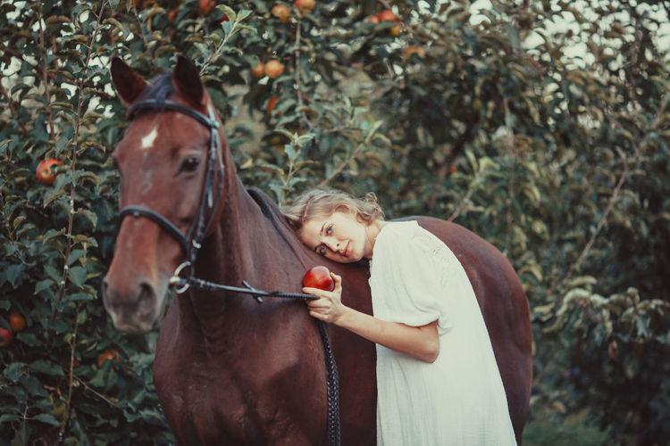 Portrait of a girl with horse