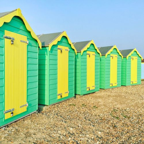 On the beach Beach Hut Beach Hut In A Row Sky Beach Day Architecture Side By Side Multi Colored Clear Sky Summer Road Tripping