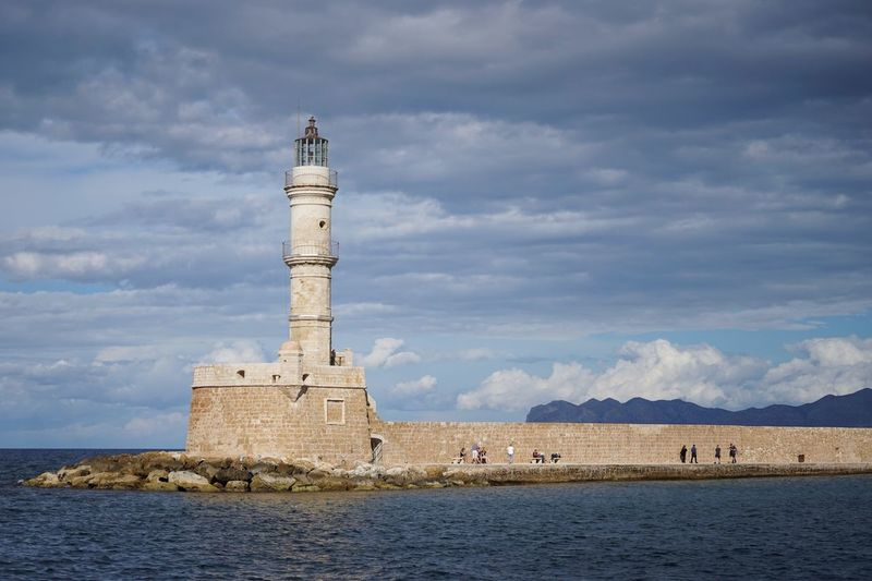 Historic lighthouse, Chania old town Harbour Cloud - Sky Sky Architecture Lighthouse Water Built Structure Tourism Outdoors Building Exterior History Sea Day Travel Destinations Mountain Beauty In Nature
