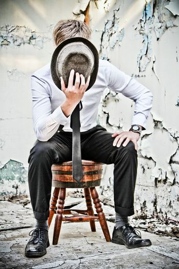 Young man sitting on chair
