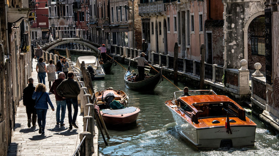 People and boats in Venice, Italy Tourists Venice, Italy Boats People Tourism Travel Destinations Water Water Traffic Water Transportation