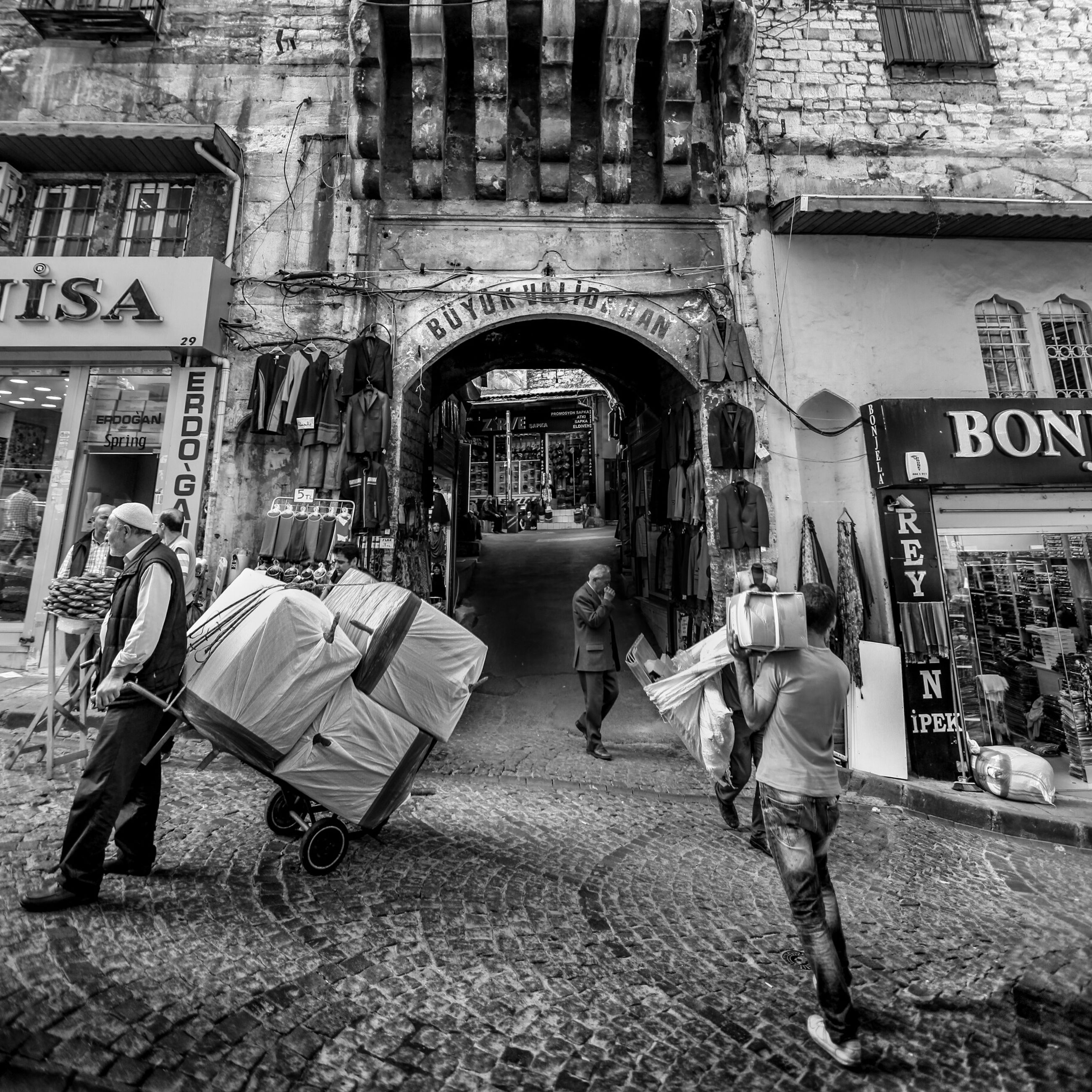 architecture, building exterior, built structure, street, city, transportation, mode of transport, land vehicle, day, bicycle, building, outdoors, cobblestone, city life, incidental people, sidewalk, residential building, store, chair, empty