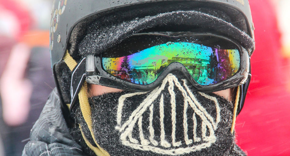 Close-up of person wearing mask during winter