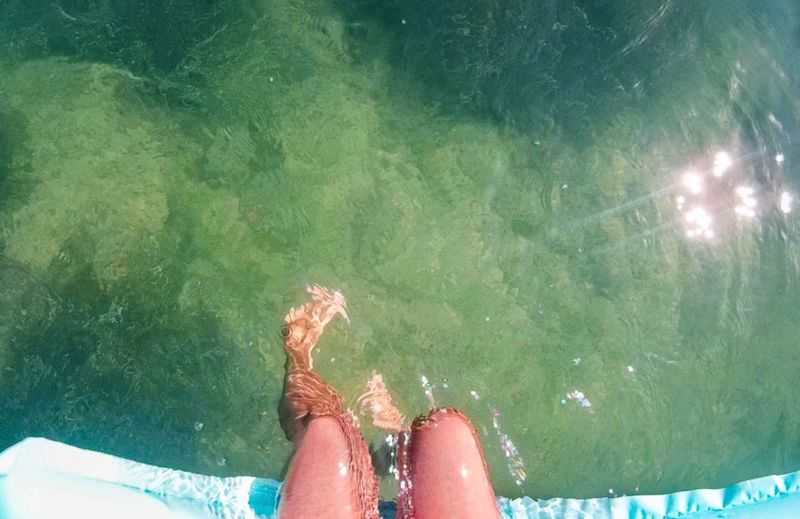 Sea Floating On Water Human Leg Human Body Part Low Section Water One Person Personal Perspective Women Body Part Real People Leisure Activity Lifestyles Human Foot Adult Day Sunlight Nature Be Brave Moments Of Happiness