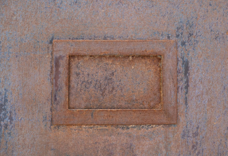Close-up No People Full Frame Architecture Design Backgrounds Wall - Building Feature Day Shape Building Exterior Craft Pattern Built Structure Outdoors Door Geometric Shape Entrance Copy Space Letter Ornate Blank Metal Corrugated Iron Square Copy Space
