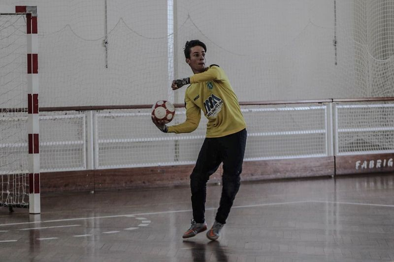 Young man playing with ball