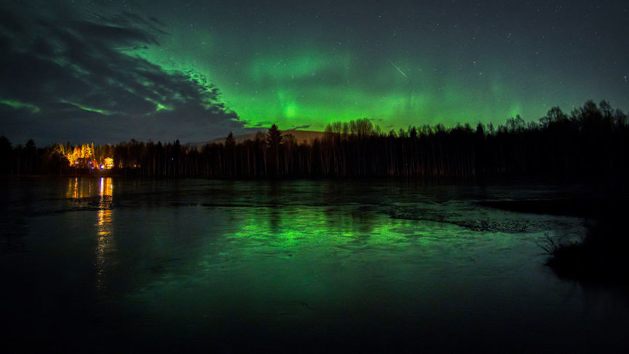 Aurora over Ånge. Beauty In Nature Night Sky Water Scenics - Nature Reflection Tree Tranquil Scene Tranquility Green Color Illuminated Nature Plant Cloud - Sky Lake Idyllic Non-urban Scene Silhouette Outdoors Astronomy Aurora Polaris Power In Nature Aurora Borealis Long Exposure Olympus