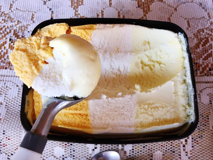 Directly above shot of ice cream in scoop on table