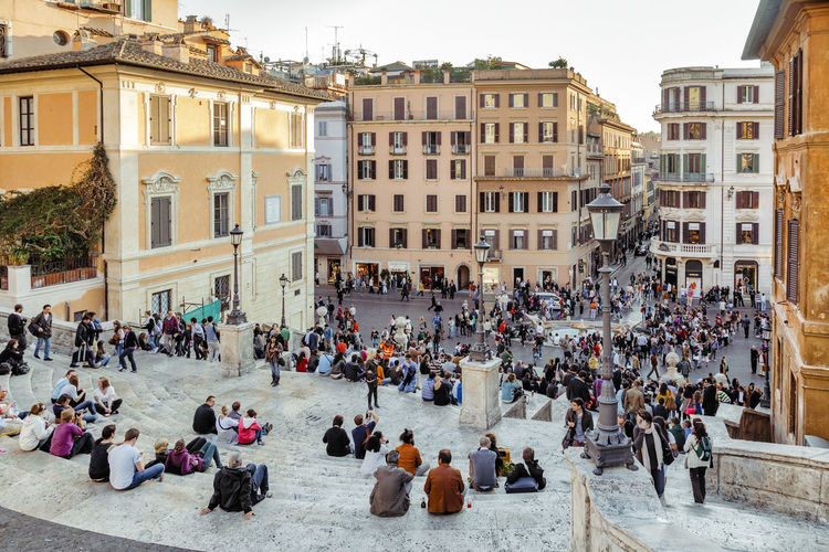 High angle view of people sitting on the famous Spanish Steps and looking over Piazza di Spagna in Rome, Italy. This monumental stairway has 135 steps and is one of Rome's most popular tourist attractions. Architecture City Life Cityscape Roma Rome Scalinata Di Trinita Dei Monti Spanish Steps Steps TOWNSCAPE Tourist Tourist Attraction  Urban Lifestyle Building Building Exterior Built Structure Crowd Famous Place Italy Large Group Of People People Piazza Di Spagna Steps And Staircases Tourism Travel Destinations Via Condotti Moving Around Rome