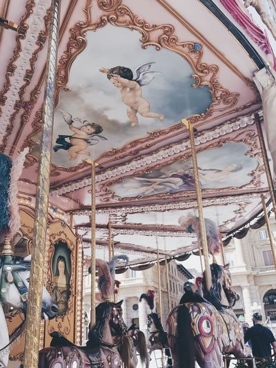 Low angle view of carousel at amusement park