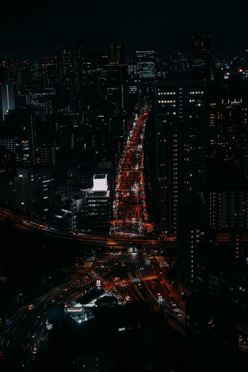 High angle view of roads in illuminated city at night