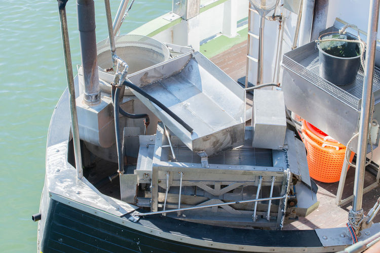 High angle view of machinery in ship moored on sea