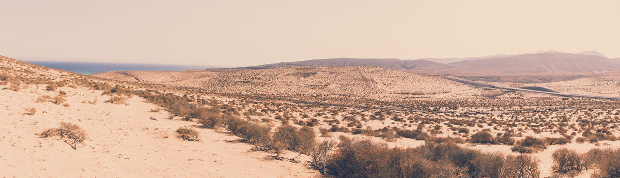 Panoramic view of desert against clear sky