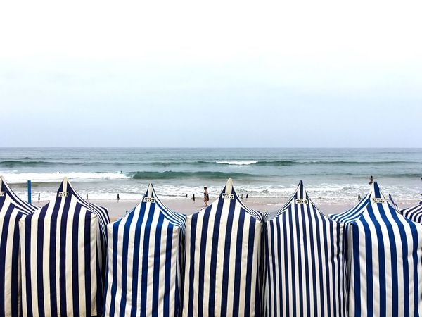 Beach cabins, Zarautz, Basque Country Striped Horizon Over Water Sea Beach In A Row No People Day Water Outdoors Sky Nature Beach Cabins Zarautz Your Ticket To Europe