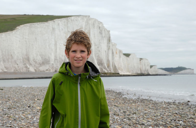 Portrait of smiling boy standing on beach