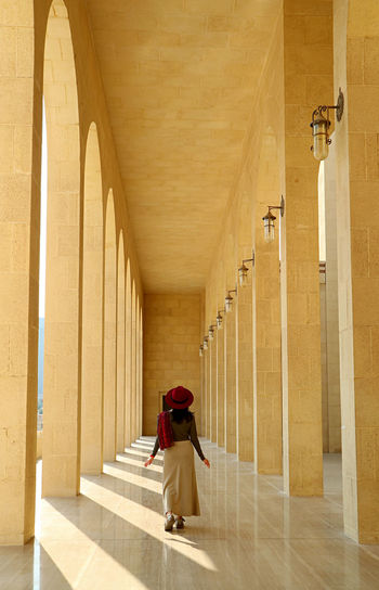 Rear view of woman on corridor of building