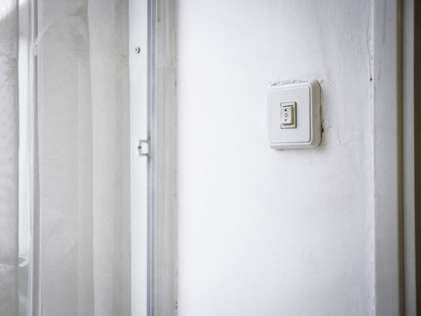 A switch button on a white wall to open up or to close down Appartment Button Choice Decisions No People Push Button Switch Up And Down Wall White Wall