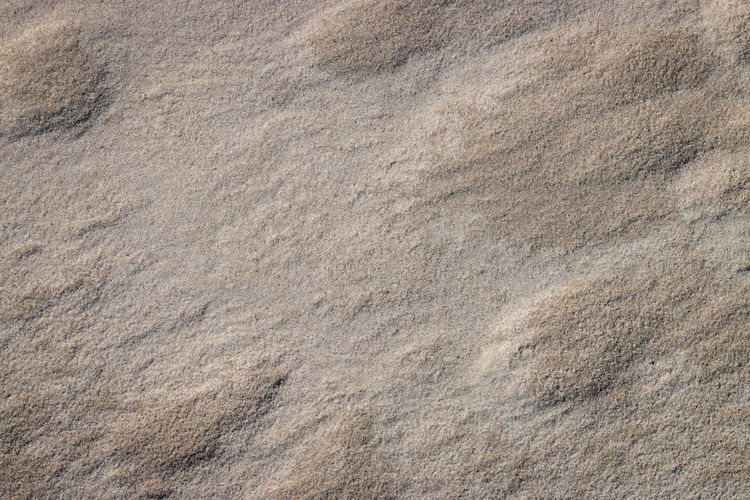Full frame shot of rocks on sand