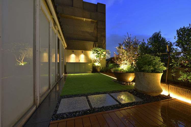Warm and bright home environment, artificial turf and plank with the use of space. Artificial Turf Beautiful Home Life Modern Natural Architecture Board Building Exterior Built Structure Comfortable Fresh Garden Design Grass Illuminated Landscape Luxury Nature Night No People Outdoors Sky Space Style Texture Tree