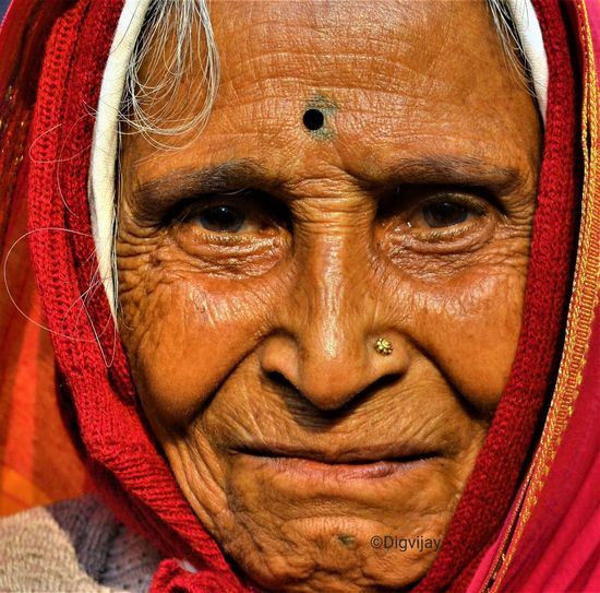 Aged With Charm. Looking At Camera Portrait Human Face Close-up One Person Front View Human Eye People Day Outdoors Village Woman Lifestyles Women Saree One Woman Only Outdoor Photography VillagePeople Real People Villagelifestyle