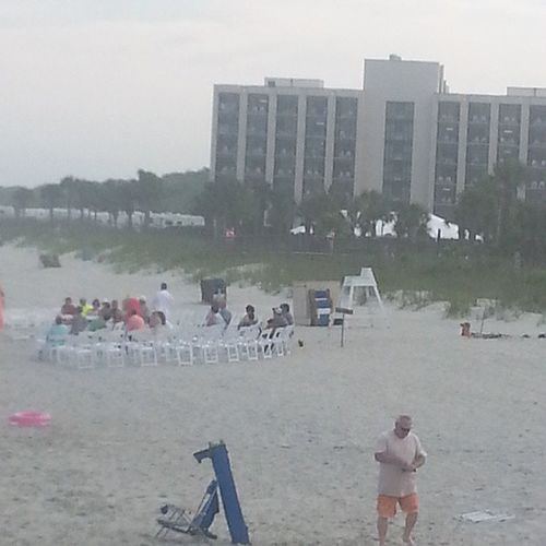 They're setting up for a wedding on the beach