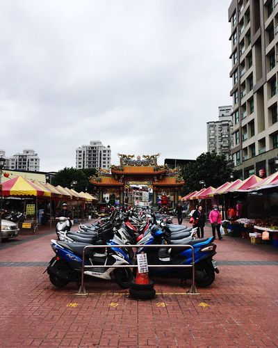 Rows of Motorbikes Building Exterior City Built Structure Architecture Sky Outdoors Day EyeEm Gallery Eyeem Photography EyeEm Taiwan Place Of Worship Urban City City Life EyeEmNewHere Motorcycles Transportation Parking Parking Lot Gate Dragon EyeEmNewHere Welcomeweekly EyeEmNewHere